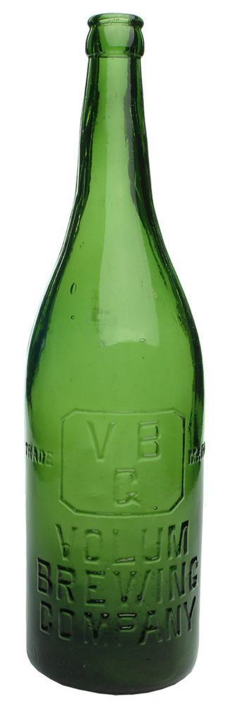 Embossing: Trade (VB / G in a bevelled rectangle) Mark / Volum / Brewing / Company // This bottle is not sold / & still remains the property / of the Volum Brewing Co. Ltd. Small punt to base. (Geelong, Victoria) Type: Beer Crown Seal /  Era: 1910s /  Variety: Champagne. Spun finished top. Green. 26 oz. /  Height: 308 mm /  Condition: Excellent. General fine scratches and scuffs. A bit of very light internal haze. Great embossing. Lovely bottle. /  Grade: 8.1 /  Estimate:  $ 30 -  $ 40…