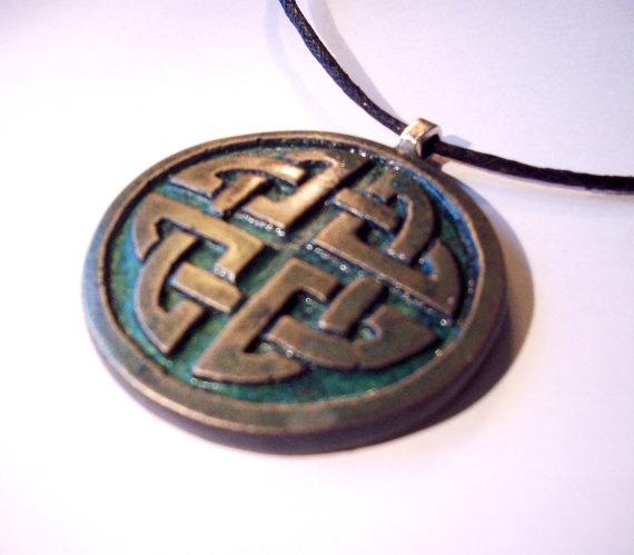 Aged bronze celtic pendant by GelertDesign on Etsy, £6.00