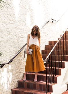 Yellow skirt and white top with heels. Cute casual outfit.