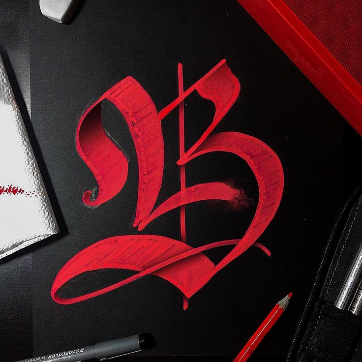 Letter B, red gothic calligraphy.
