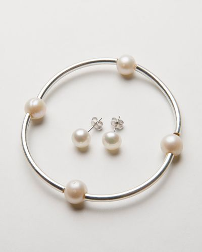 PIPE & PEARL SILVER BRACELET $38.00  This beautiful bracelet is a delicate sterling silver pipe bracelet on stretch band, crafted with freshwater pearls and is the perfect accompaniment to all of our other bracelets within our collection. Worn alone or with any of our beautiful collection this stunning and simplistic bracelet is the most gorgeous petite addition to any ladies jewellery collection.