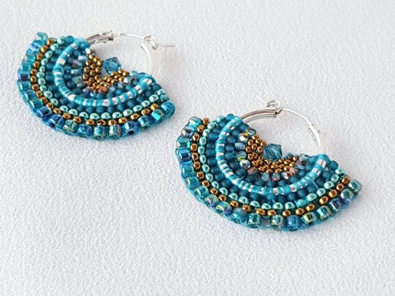 Beautiful butterfly-wing hoop earrings beadwoven of teal and bronze seed beads. *** This is a made-to-order item. I do not have one in stock, I will make one to your specifications - just for you. Made-to-Order items generally ship about a week after the order is received but if I have an order backlog, it could be longer. If timing is an issue, please contact me to find out my current schedule. *** Mariposa is the Spanish word for butterfly and these beautiful earrings are inspired by the…