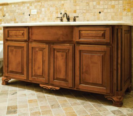 Cabinet Feet And Wood Accents Added To Make A Custom Bathroom Cabinet.