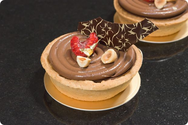 """""""Hazelnut and almond tartlet filled with sea salt caramel, raspberry compote and dacqouise.."""" then topped with that amazing Amedei Toscano cremeux.  William Curley, London"""