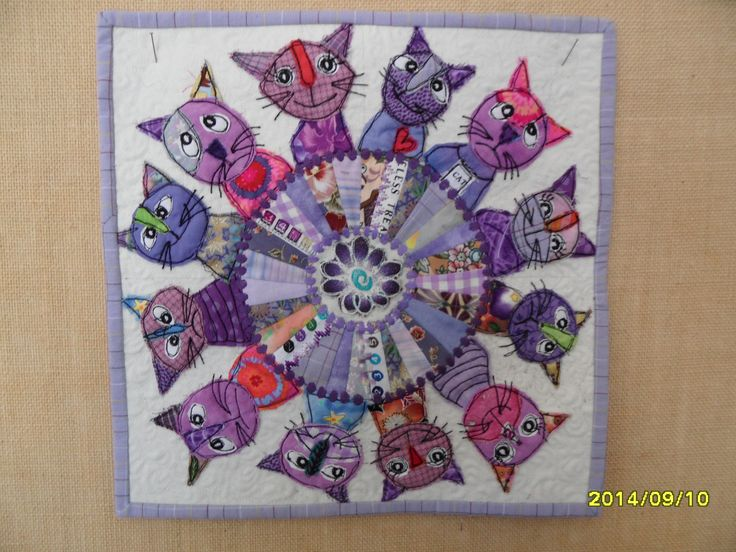 Griet Lombard : Knights of the Round Table. A 12 x 12 purple challenge which won first prize. Machine applique and machine embroidery