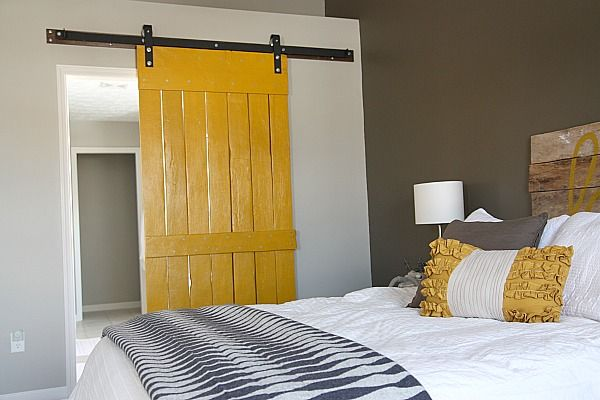 Love=yellow BARN door, love the pillow, the headboard all of it