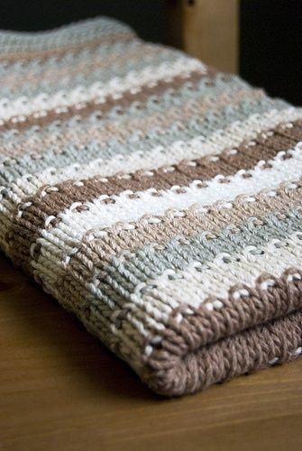 PRETTY knitted blanket. Knitted in stockinette stitch with seed stitch in between colors. Garter stitch border.