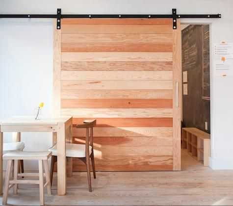 In today's Hotels, Lodging & Restaurants: Seesaw Cafe in San Francisco, we especially like the sliding barn door that divides the space. For more ideas on using barn doors in domestic environments, go to Hardware: Barn Door Fittings and Architectural Elements: Interior Sliding Barn Doors.
