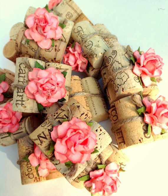 Unique Place Card Holders!  Coral flowers & natural twine wrapping around vintage wine corks.  Explore more seating & table decorations at www.karasvineyardweddingshop.com
