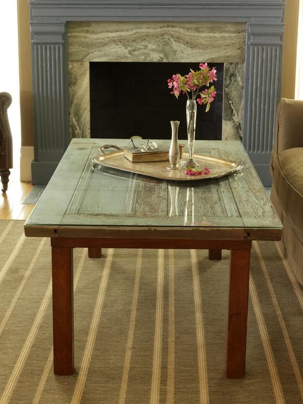 Ideas For Creating Upcycled Tables, Desks and Workstations: The base of an old coffee table and a salvaged door found at a resale shop were cleaned up then attached. A new piece of glass was laid upon the top to create a beautiful new table. From DIYnetwork.com