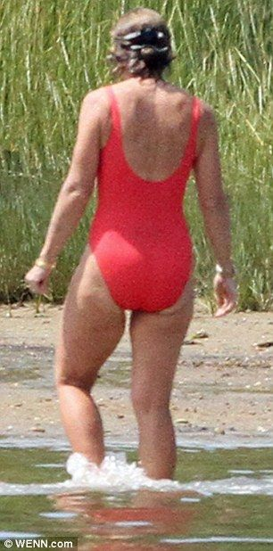 Lady in red: The 55-year-old revealed her toned physique in a low-back swimsuit  Read more: http://www.dailymail.co.uk/femail/article-2402142/Caroline-Kennedy-enjoys-Marthas-Vineyard-break-son-John-Schlossberg-20.html#ixzz2hA4JDHDv  Follow us: @MailOnline on Twitter | DailyMail on Facebook