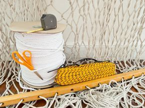 #DIY TWO-TONE SAIL ROPE HAMMOCK. This might be the perfect summer project. #Weaving is an amazing way to relax. The repetition and handiwork are incredibly cathartic—and when you're done, you've made a place in which you can lay back and lounge.