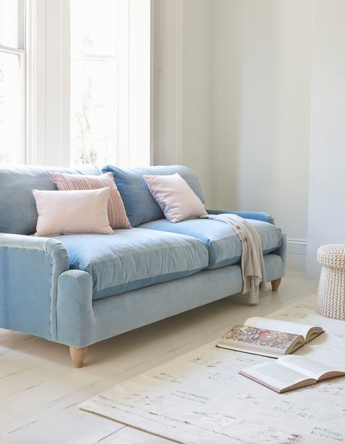 Loafs Comfy Pavlova Sofa Upholstered In A Light Blue Velvet With Pastel Pink Scatters This