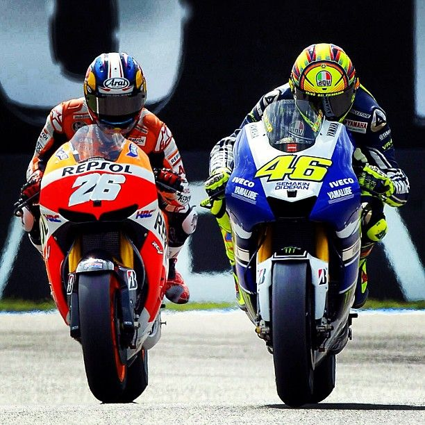 Dani Pedrosa, as Valentino Rossi goes for the pass, Assen, 2013