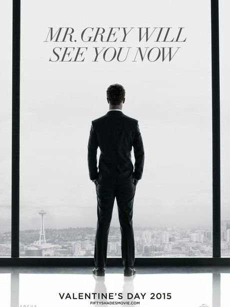 jamie dornan as christian grey looking out of a window