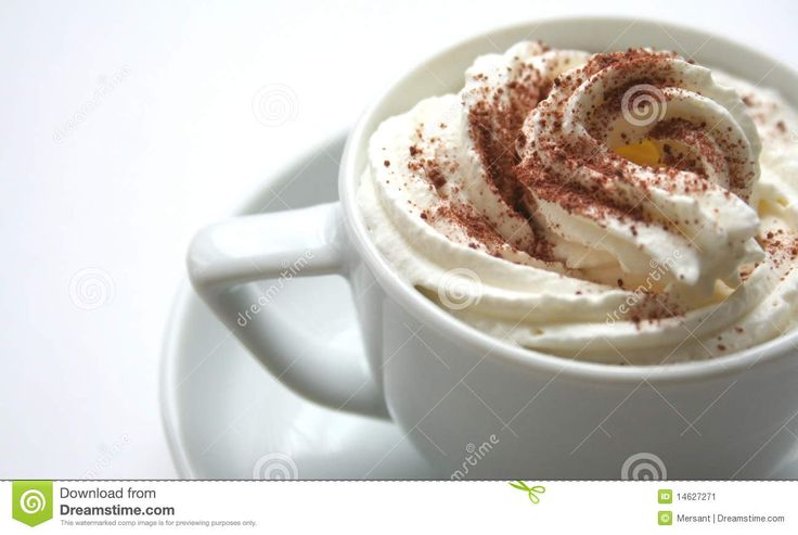 A cup of coffee and  whipped cream with cocoa dust