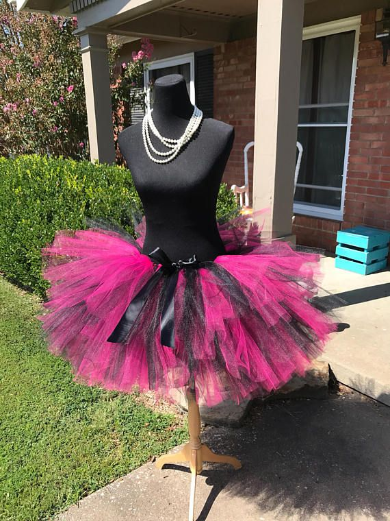 This listing includes a Fuchsia and Black mixed tutu for waist sizes up to 34 1/2 can be made larger if interested contact me for a special listing. Other colors also available. Tutu pictured is a 15tutu with a top layer that is 12. Tutu can be all one length or the dual lengths.