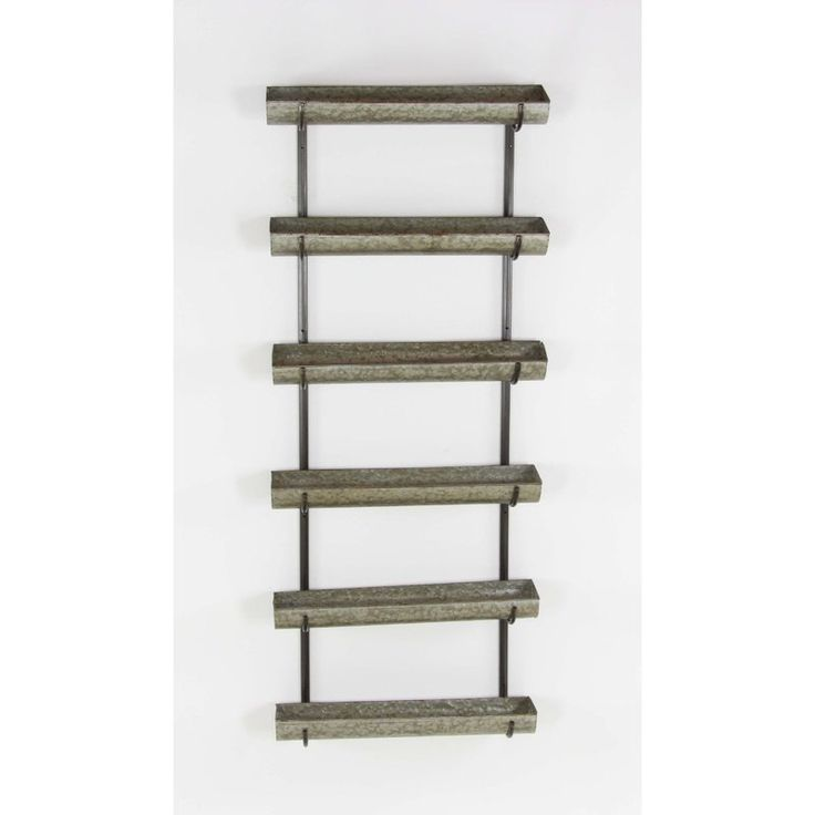 This metal wall planter is having 6 shelves. The metal wall planter is skilfully crafted to be balanced and durable. You can place it indoor or outdoor any place of your choice. You are sure to win some kudos with this planter at home.