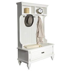 """Rubberwood hall tree in white with 2 louvered doors and antiqued brass hardware.   Product: Hall treeConstruction Material: Rubberwood and metalColor: WhiteFeatures: Two shutter doors and four double hooksDimensions: 64.5"""" H x 40"""" W x 18.5"""" D"""