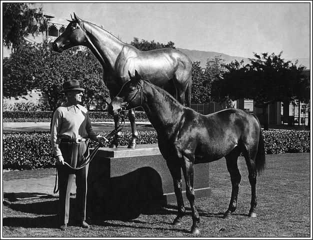 Owner Charles Howard with Seabiscuit next to Seabiscuit's statue at Santa Anita Park