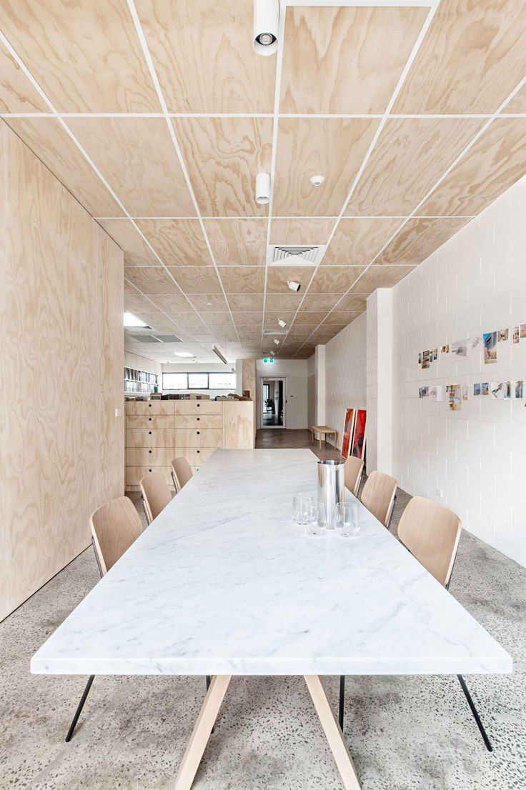 White-painted walls mix with light plywood ceiling panels and joinery to boost the feel of the spaces. Resources, such as plywood is utilised for cabinets and walls that separate public and circulation areas from the workspaces, were specified in an untreated state to lower their cost and ecological impact.