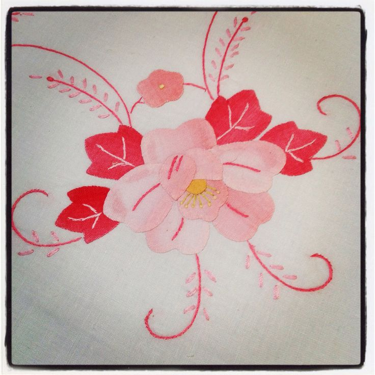 Pretty pink embroidered flower.