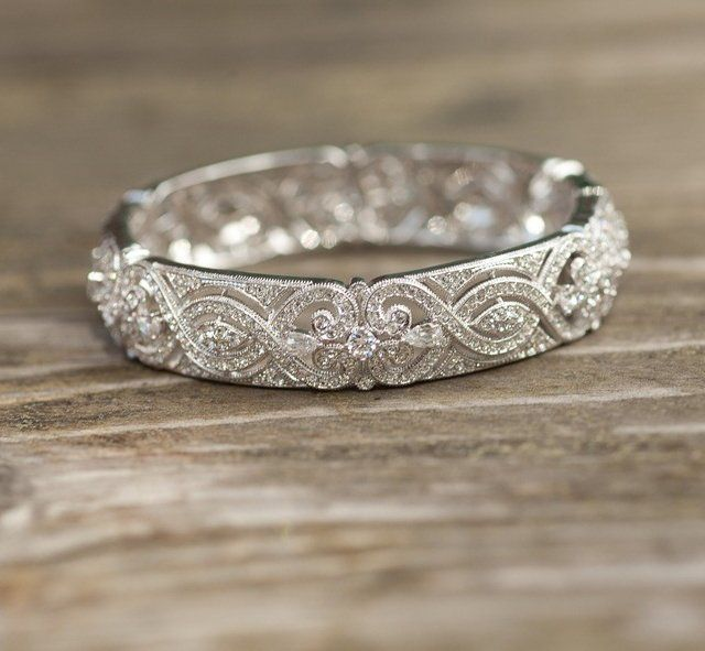 "Handcrafted filigree bangle By Nadri is made with hand-set crystals. Tongue-and-groove closure. Approx. inner circumference: 7"" Approx. width: 1/2"" Crystals: 18k gold or rhodium-plated base metal. Please allow 3-4 weeks for shipping."