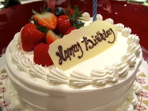Light fluffy sponge cake with fruit and cream filling and ...