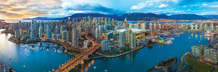 """Vancouver panoramic. 1000 piece puzzle. Finished puzzle Size: 13"""" x 39"""" (99cm x 33cm). Vancouver is a bustling west coast seaport in British Columbia.  It is among Canada's densest, most ethnically diverse cities."""