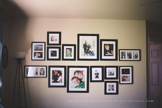 I love how this aligned from the horizontal plane. creative wall displays   get those photos off your hard drive   ClickinMoms
