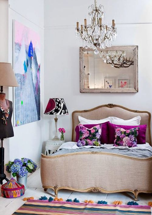 Neutral walls and silk bed frame with magenta accents - gorgeous eclectic bedroom