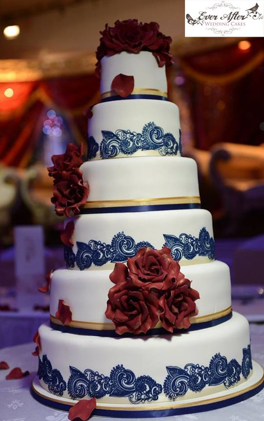 6 Tier wedding cake with Maroon roses, edible Navy lace and Gold detail