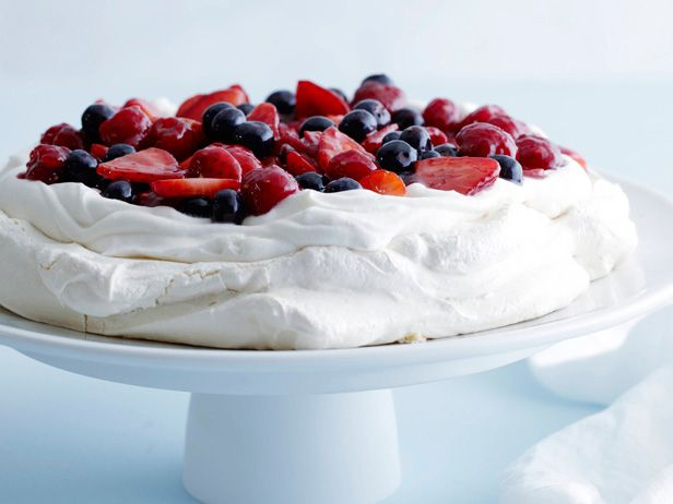 A cloud of crisp meringue is crowned with fresh whipped cream and berries in this easy, elegant dessert.