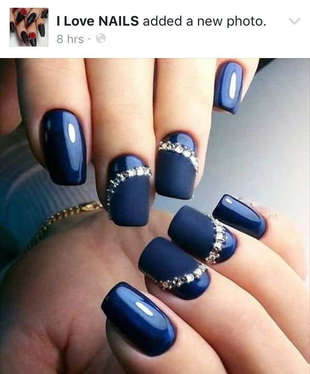 Blue acrylic nails with rhinestones