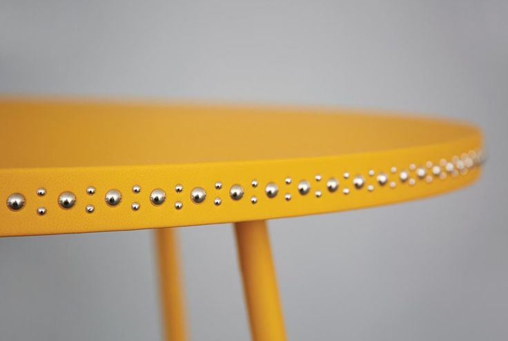 Yellow leather and nickel stud coffee table  http://bethangray.com/products/stud-occasional-1