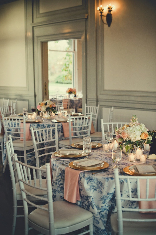 Blue toile patterned linen + peach napkins. Photography by carlateneyck.com, Event Design   Coordination by sixpenceevents.com, Bridal Styling by jenniefresa.com, Wedding Gown by plumedserpentbridal.com