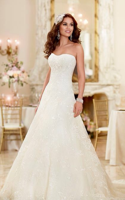 I absolutely love this style and everything about this dress, it's elegant and beautiful, not over the top with detailing, it's subtle and flattering. Pretty close to my dream wedding dress