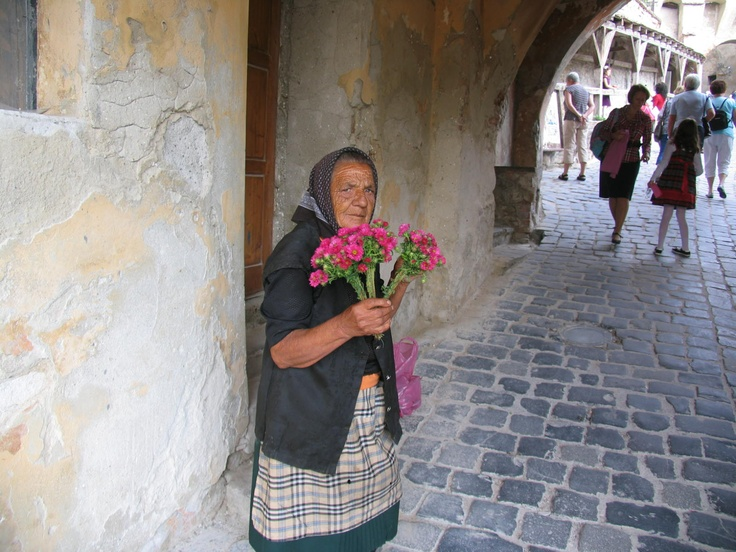 Friendly Romanian giving flowers, almost for free