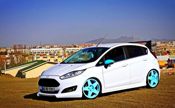 White Ford Fiesta mk7 with blue elements and big rims