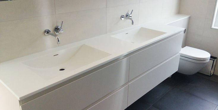 Corian bathroom shelves, custom made Corian basins & Corian bathroom worktop installation in London.