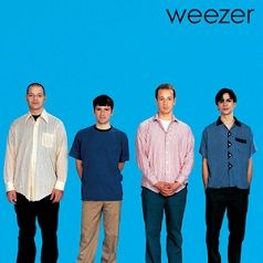 """Weezer formed in Los Angeles in 1992, consisting of Rivers Cuomo (lead vocals, guitar), Patrick Wilson (drums), Brian Bell (guitar, backing vocals, keyboards), and Scott Shriner (bass guitar, backing vocals). Weezer has sold 9.2 million albums in the US and over 17 million worldwide. After signing to Geffen Records in 1993, the band released its debut known as the Blue album with """"Buddy Holly"""", """"Undone – The Sweater Song"""" and """"Say It Ain't So"""". The http://weezer.com/ click gets you more…"""
