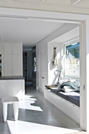 window seat in kitchen, storage under. Like the section with wooden bowl instead of cushion. Love the grey floor,mush ions and bench, white walls