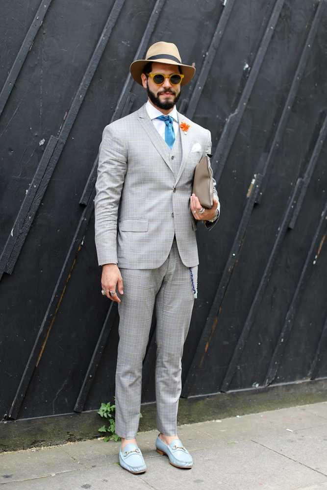 Kadu Dantas wears Topman trilby hat, Ricardo Almeida grey check suit, Hermes tie, Moina Bag and Gucci loafers.  LC:M S/S 2016 Mens Street Style. London.