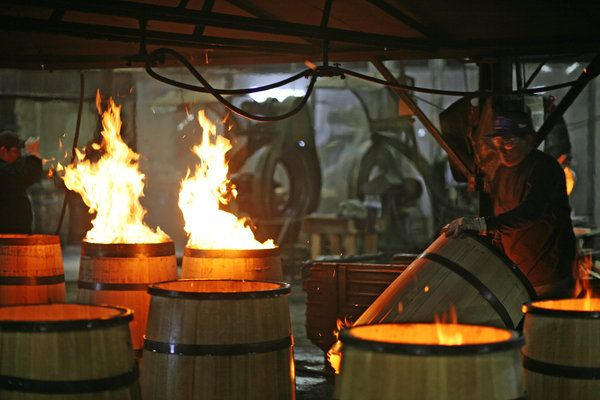 Kelvin Cooperage, owned by brothers Kevin and Paul McLaughlin, is making white oak barrels for the newly-rising craft distillers. Here, oak scraps are burned inside the finished barrels to char them.