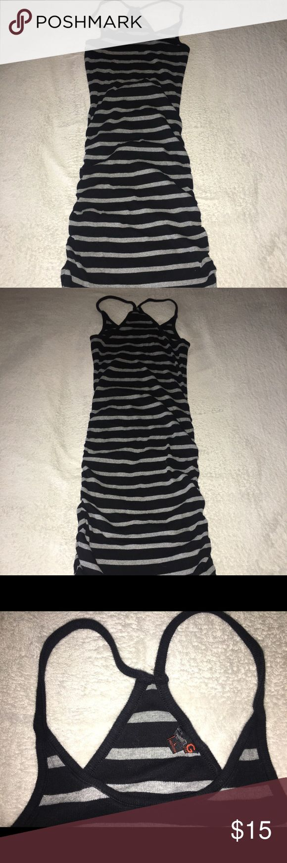 Guess Dress Women's Large I have a comfy black and gray striped Guess dress in a Large. It is an easy pull over that is great for the summer or by the pool. It's gathered perfectly along both sides to give a great look.   Ask questions, make offers, and all sales are final. Thank you for POSHING❣️ Guess Dresses