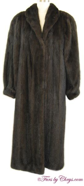 """Long Mahogany Mink Coat MM793; $1200; Very Good Condition; Size range: 8 - 16. This is a gorgeous genuine natural mahogany mink fur coat in a very deep, dark almost ranch mink color and in a nice long length. It has an Evans label and features a small shawl collar, banded bracelet cuffs, and has shoulder pads.  This is a high-quality mink coat which is fully interlined and has very generous 14"""" sleeve openings to accommodate bulky clothing. Buy this elegant dark mahogany mink coat and be…"""