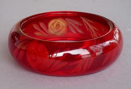 Lovely red reverse carved sherry Prystal Bakelite bracelet.