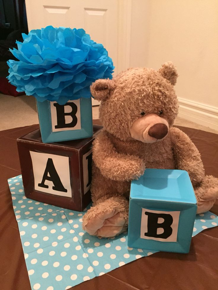 Alphabet blocks and teddy bear themed centerpiece.