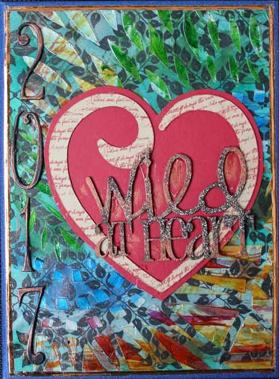 Stencilling and alcohol ink have totally changed a background paper for my Wild at Heart Journal