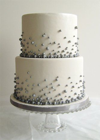 Flour fancies. This is the cake I made for my daughter's friend's wedding except just one level, silver fondant with white pearl candies, and two black & white chocolate guitars on top! It was perfect for her rock and roll with a little glamour wedding! B